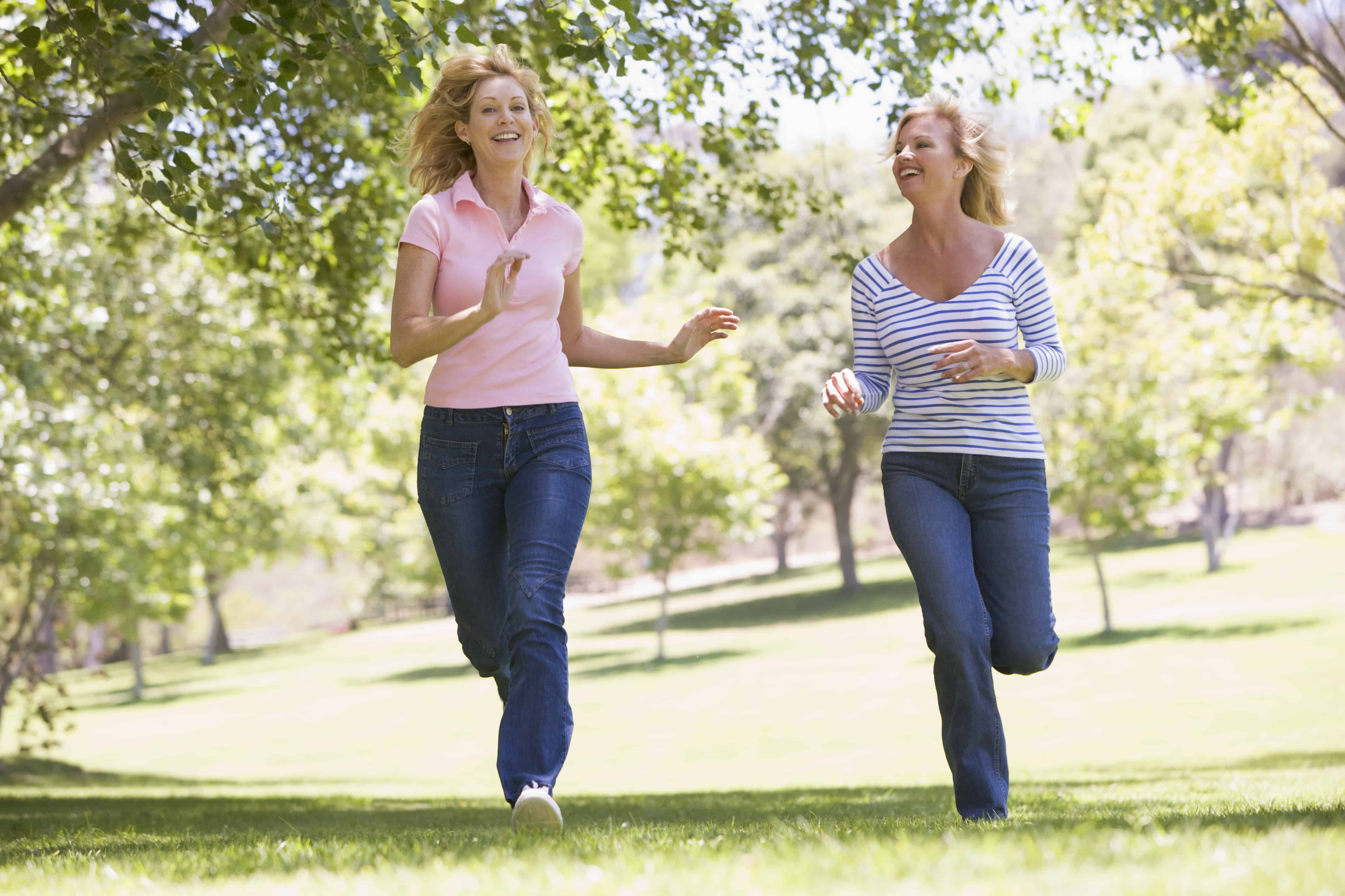 Two female running in a park